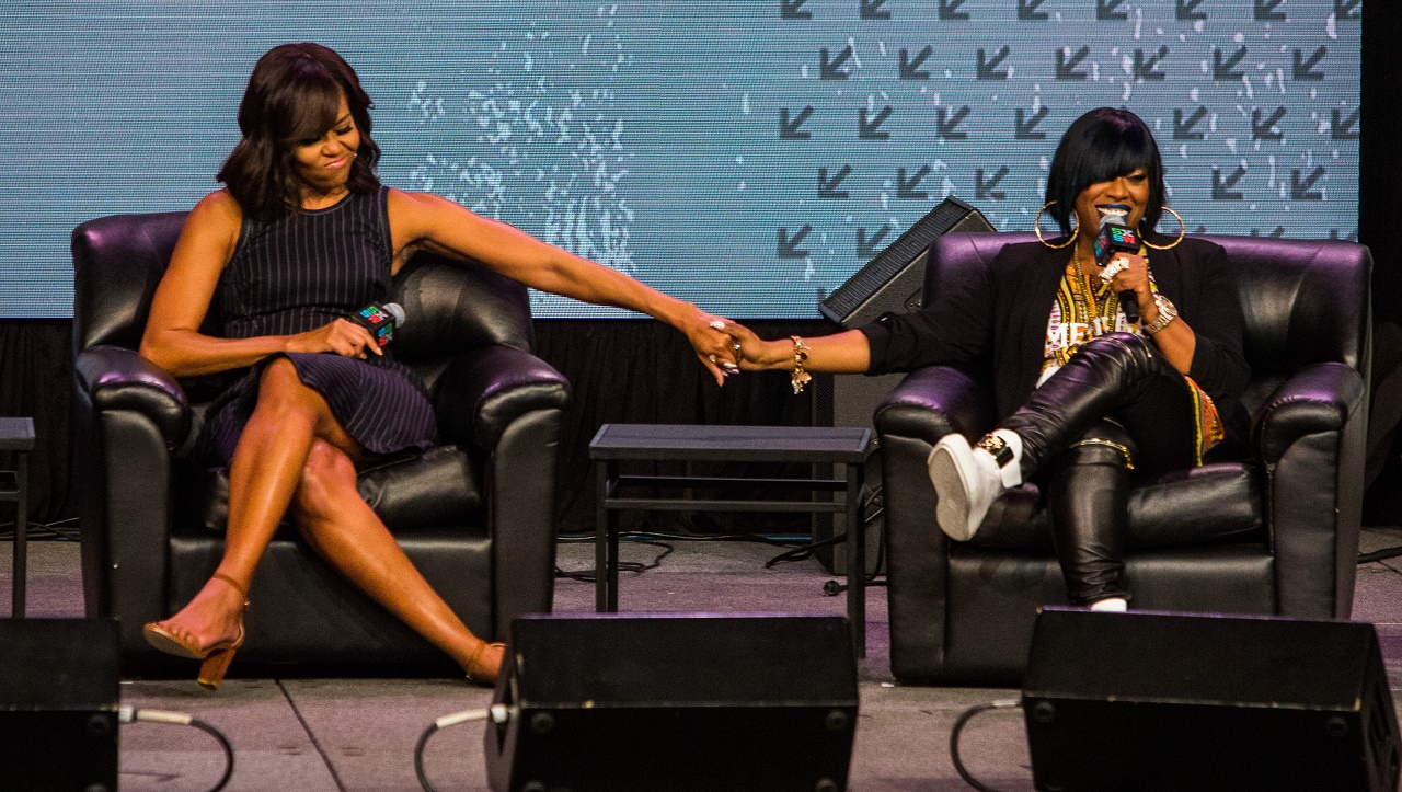 AUSTIN, TX - MARCH 16: First lady Michelle Obama (L) participates in a discussion with Missy Elliott during SXSW on March 16, 2016 in Austin, Texas. Mrs. Obama was the keynote speaker at the event. This is the 30th anniversary of SXSW. Drew Anthony Smith/Getty Images/AFP