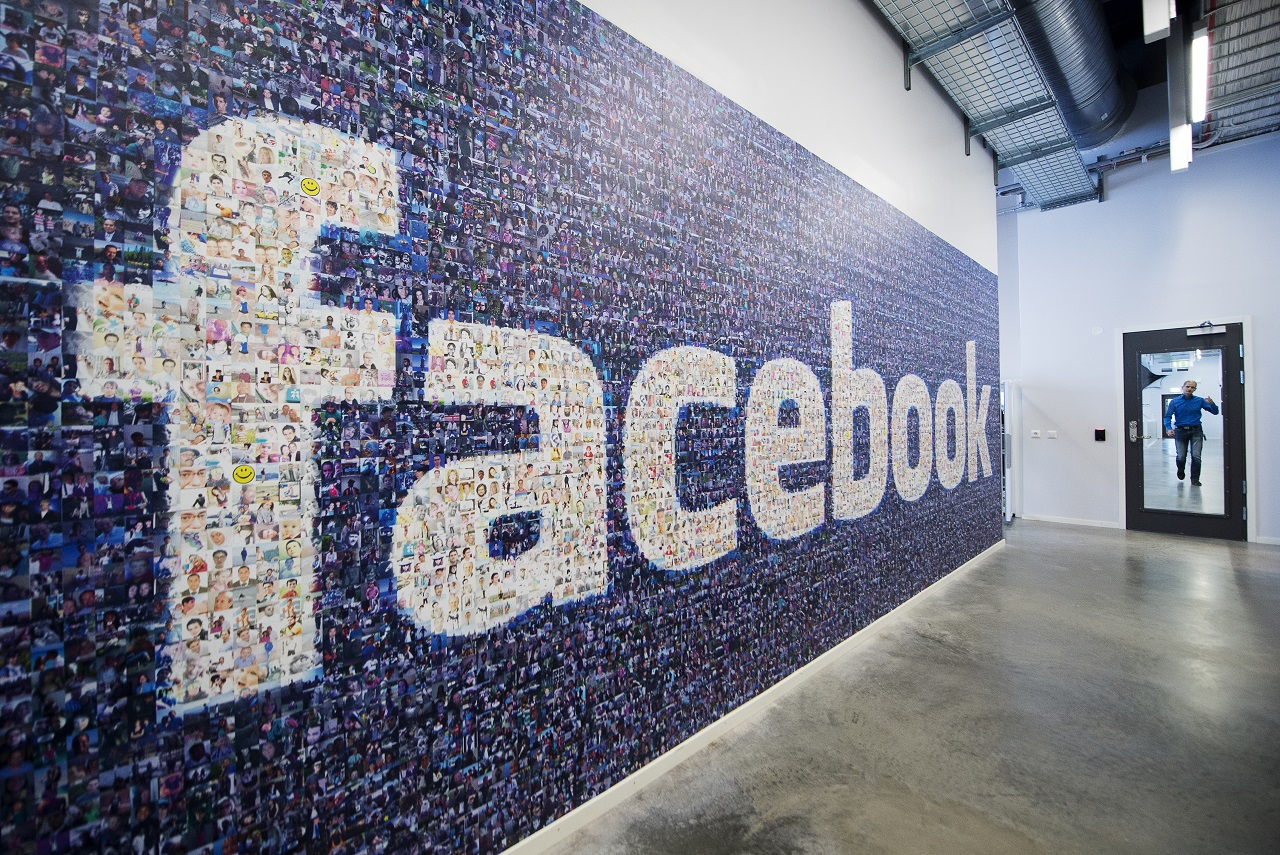 (FILES) This file photo taken on November 07, 2013 shows a giant logo created with pictures of Facebook worldwide users is pictured in the company's Data Center, its first outside the US on November 7, 2013 in Lulea, in Swedish Lapland. Facebook could be using its dominant market position to violate data protection rules, Germany's competition watchdog, the Federal Cartel Office, said on March 2, 2016, announcing it had opened a corresponding probe against the social network. / AFP / JONATHAN NACKSTRAND
