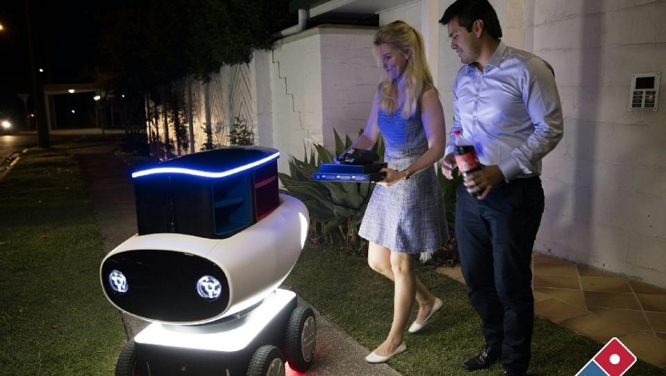 Domino's new trial pizza delivery robot in New Zealand is just under a metre (three foot) high and contains a heated compartment that can hold up to 10 pizzas. (AFP Photo/)